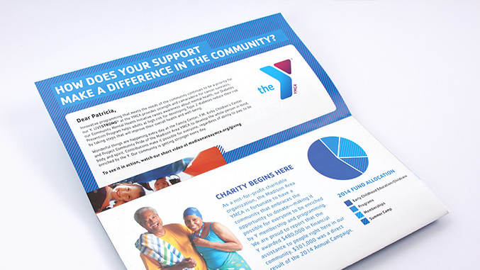 Opening panel view of the award-winning not for profit direct mail design for the YMCA of Montclair in NJ.